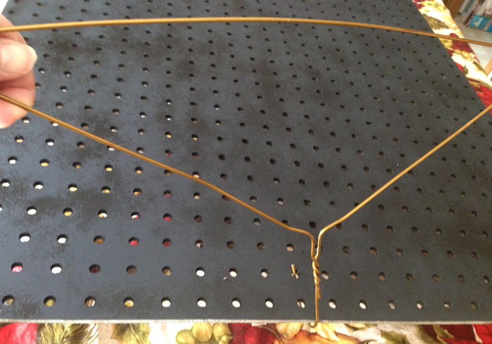 Use a coat hanger to move painted pegboard {Love My DIY Home}